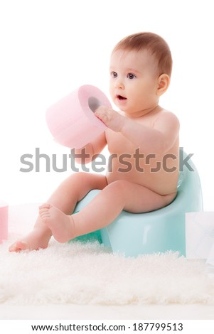 beautiful little baby on the potty with toilet paper. isolated on white background