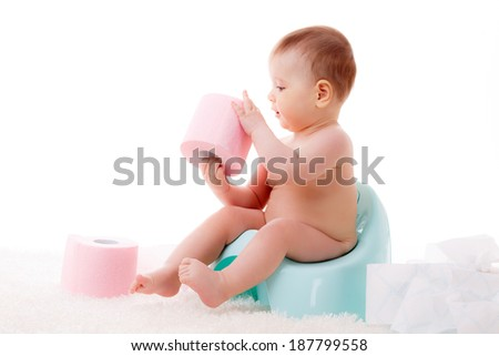 beautiful little baby on the potty with toilet paper. isolated on white background - stock photo