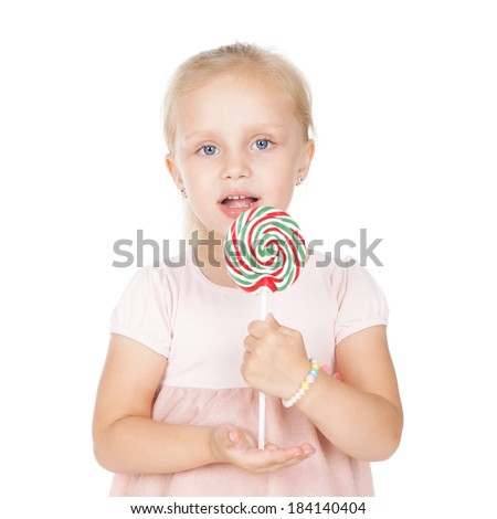 Beautiful little blonde girl holding a big lollipop over white background - stock photo