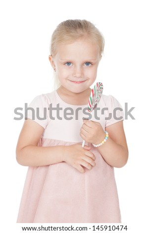 Beautiful little blonde girl with a lollipop over white  - stock photo