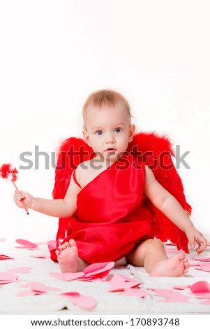 beautiful little boy dressed as Cupid. in the hands of Red Arrow - stock photo