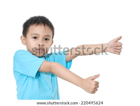 beautiful little boy giving you thumbs up - stock photo