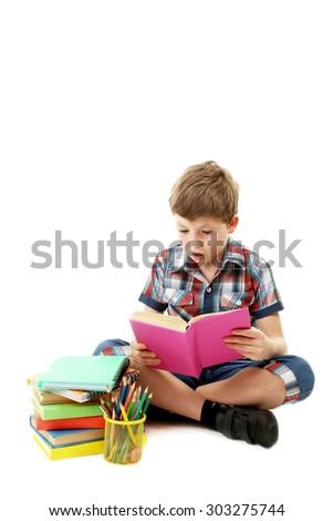 Beautiful  little boy studying isolated on white - stock photo