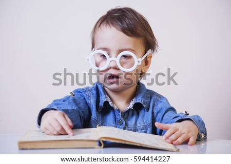 beautiful little child girl learning to read