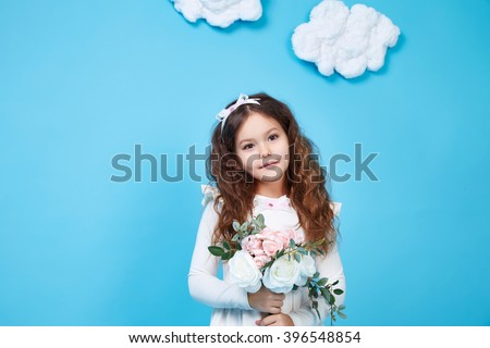 Beautiful little cute girl smile long dark hair take flower wear style fashion silk cotton dress spring mood children clothing childhood daughter pretty face collection sister friend play fun  - stock photo