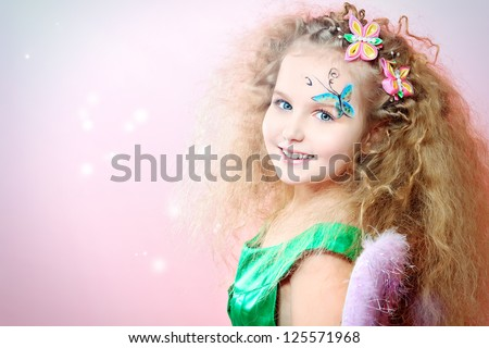 Beautiful little fairy over pink background. - stock photo