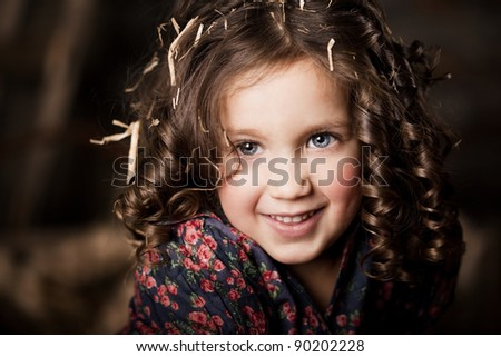 Beautiful little girl, a child on the farm - stock photo