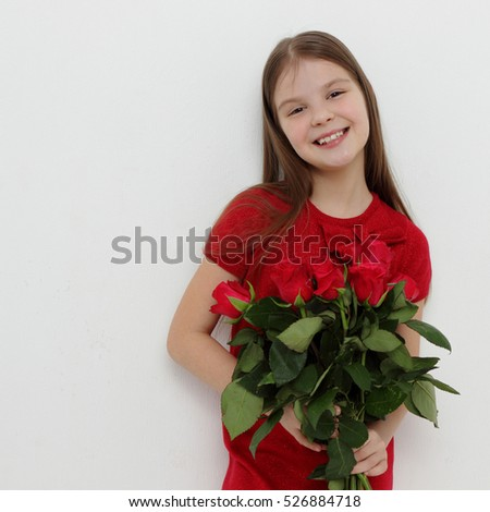 Beautiful little girl and red roses