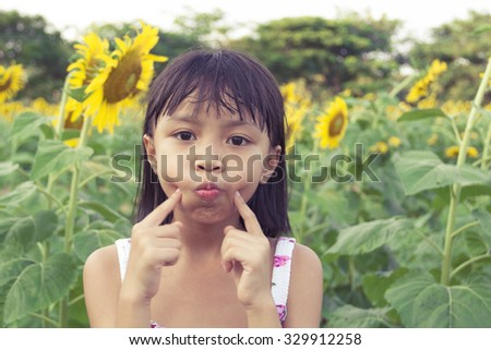 Beautiful little girl and sunflower - Vintage Filter Effect