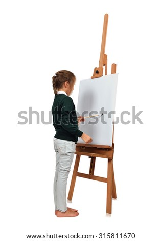 Beautiful little girl artist drawing on easel - stock photo