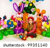 Beautiful little girl as red Riding Hood in balloon forest with balloon flower - stock photo