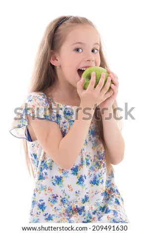 beautiful little girl biting apple isolated on white background - stock photo