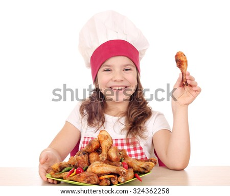 beautiful little girl cook with chicken drumstick - stock photo
