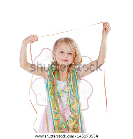 Beautiful little girl draped in party streamers as she celebrates a birthday or festival, isolated on white - stock photo