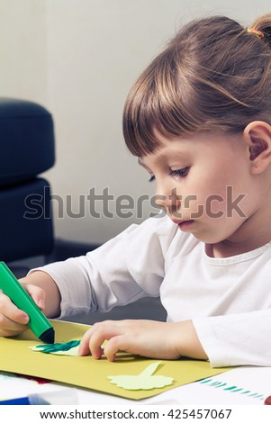 beautiful little girl draws felt pen