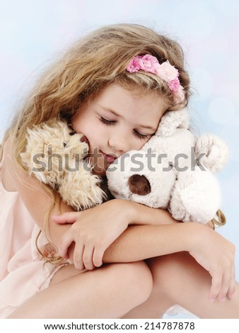 Beautiful little girl dreaming with teddy bear - stock photo