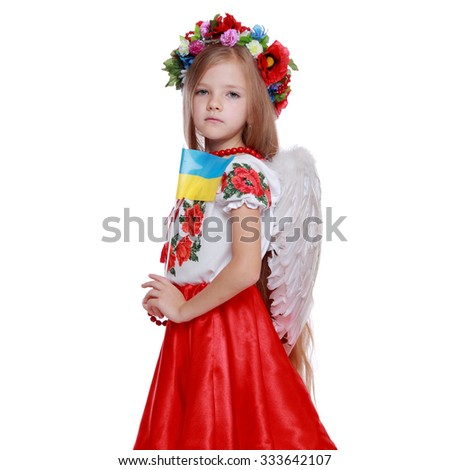 Beautiful little girl dressed in traditional Ukrainian costume over white background