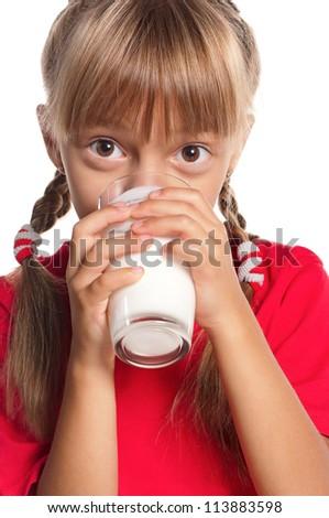 Beautiful little girl drinking glass of milk on white background - stock photo