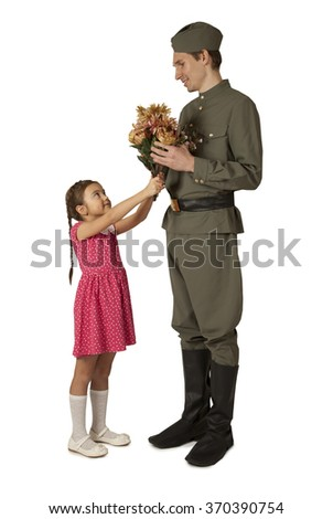 Beautiful little girl gives bunch of flowers to Soviet soldier, isolated on white background - stock photo