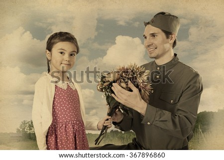 Beautiful little girl giving bunch of flowers to Soviet soldier.  Monochrome, grunge textures, intentional styled to the 1940  - stock photo