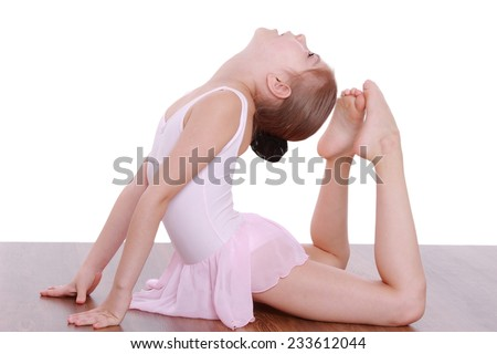 Beautiful little girl gymnast isolated over white background - stock photo