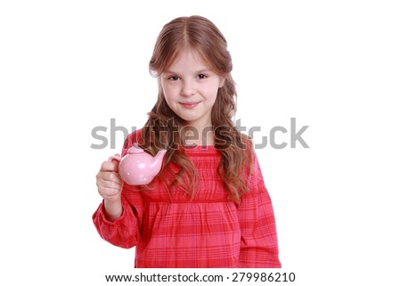 Beautiful little girl having a cup of tea playing