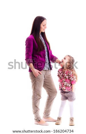 beautiful little girl her mother. Stylish clothing isolated on white background