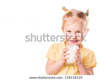 Beautiful little girl holding a cup of milk isolated on white