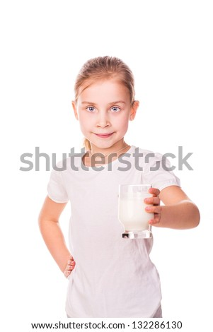Beautiful little girl holding a glass of fresh milk isolated on white - stock photo
