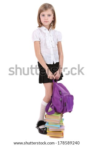 Beautiful little girl holding backpack isolated on white - stock photo