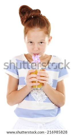 Beautiful little girl holding glass of juice isolated on white