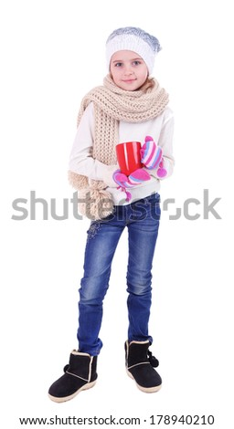 Beautiful little girl holding red cup isolated on white