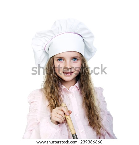 beautiful little girl in a cook cap