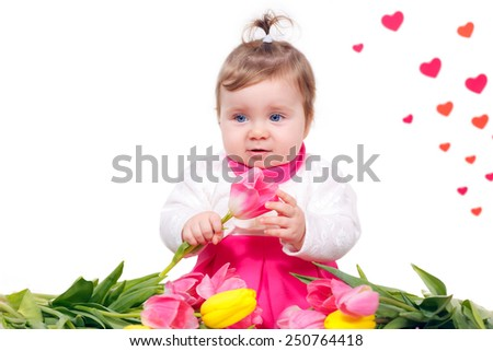 beautiful little girl in a pink dress with a bouquet of tulips.   Mother's Day - stock photo