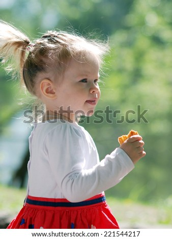 beautiful little girl in a summer day