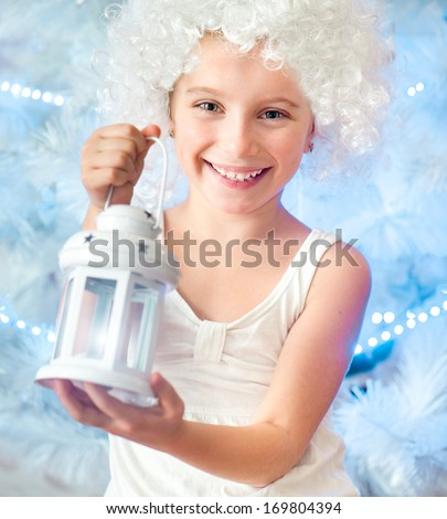beautiful little girl in a white wig keep the flashlight - stock photo