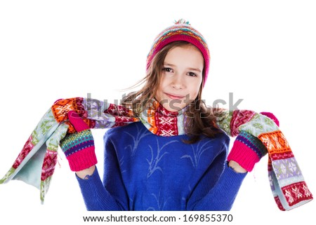 Beautiful little girl in cap and scarf isolated on white