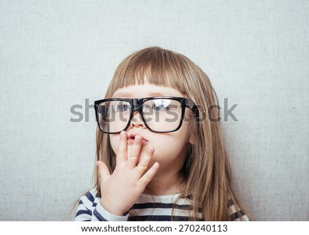 Beautiful little girl in glasses