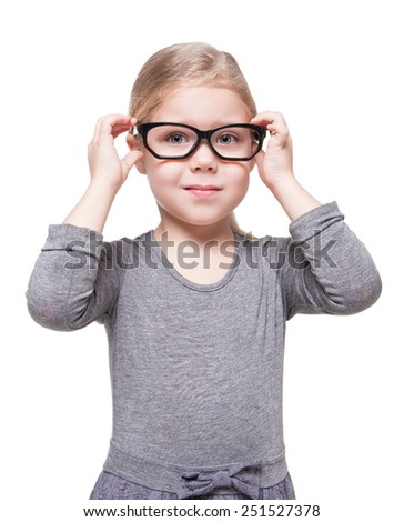 Beautiful little girl in glasses isolated over white background - stock photo