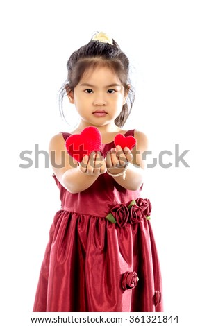 Beautiful little girl in red dress with red heart isolated on white background