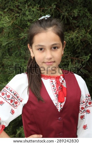 beautiful little girl in school uniform - stock photo