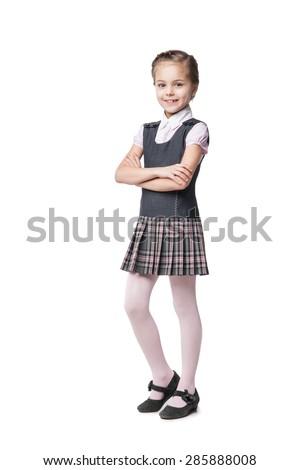 Beautiful little girl in school uniform isolated on white - stock photo