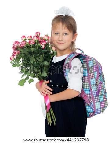 Beautiful little girl in school uniform , with a large bouquet of roses . close-up - Isolated on white background - stock photo