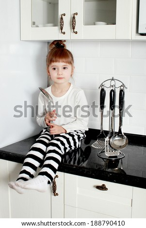 beautiful little girl in the kitchen