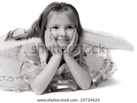 beautiful little girl in white dress with wings
