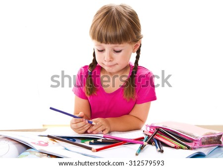 beautiful little girl is coloring with pencils her notebooks