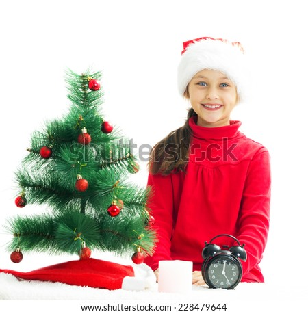 beautiful little girl is waiting the new year on a white background isolated
