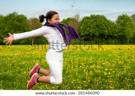 Beautiful little girl jumping on a green meadow with a colored tissue. Child playing outdoors. Girl is happy outside and having fun. #3 - stock photo