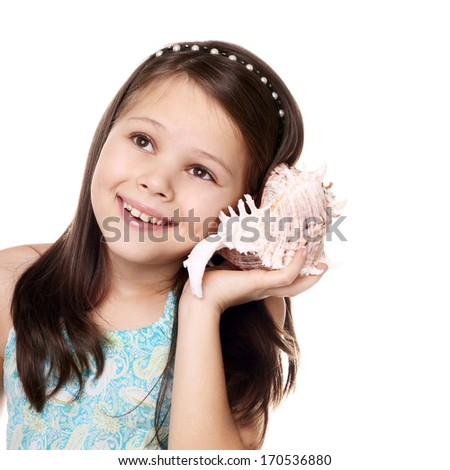 beautiful little girl listening to the seashell - stock photo