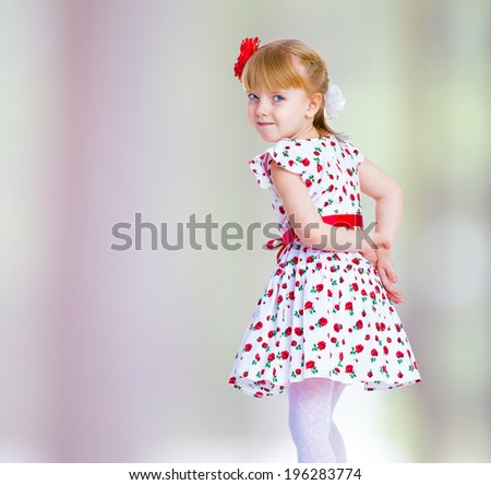 beautiful little girl on a gray - green background